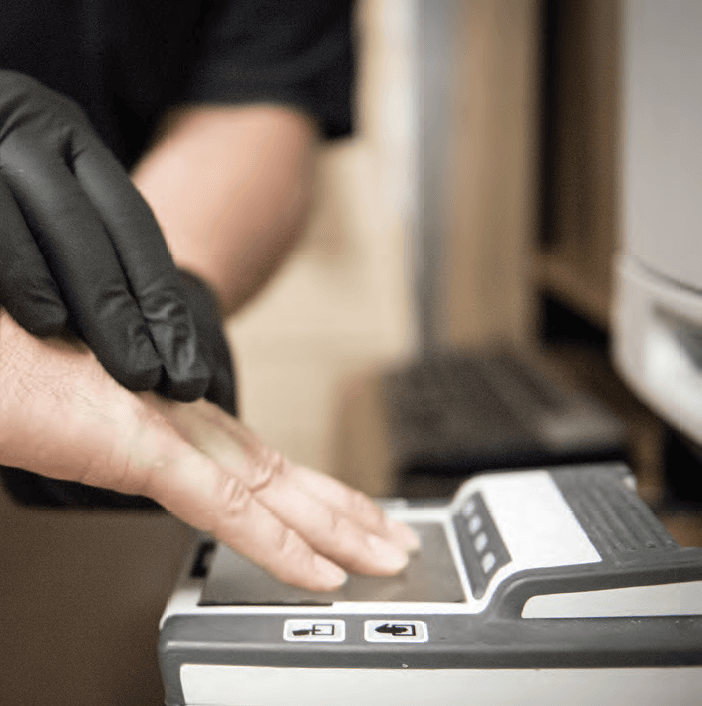 person being Fingerprinted on ink pad